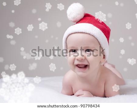 child baby in red Santa's hat
