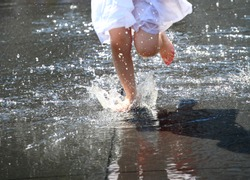 child bare feet in the water, fountain Girls feets in the water in the white dress, close up image