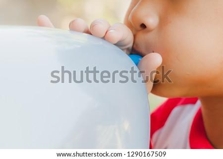 Child blowing balloon Сток-фото ©