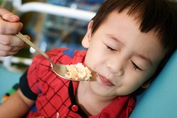 child bored with food