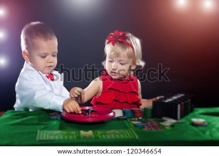 Child boy and girl playing poker