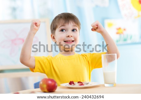 child boy eating healthy food...