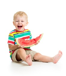 child boy eating watermelon isolated on white