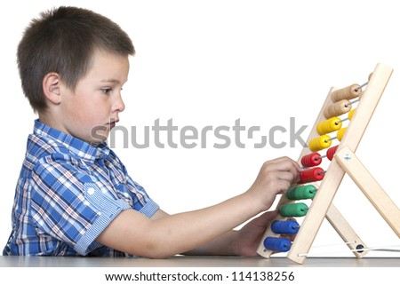 child (boy - six years old) with an abacus