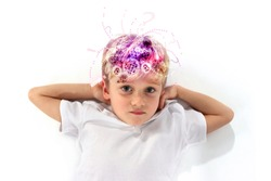 Child boy straining his mind showing how the brain works