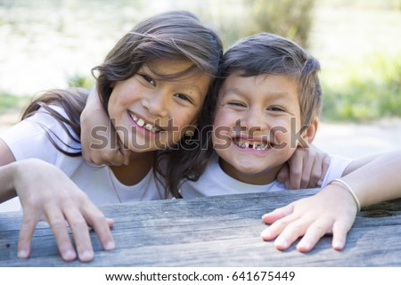 Child brother and sister laughs both
