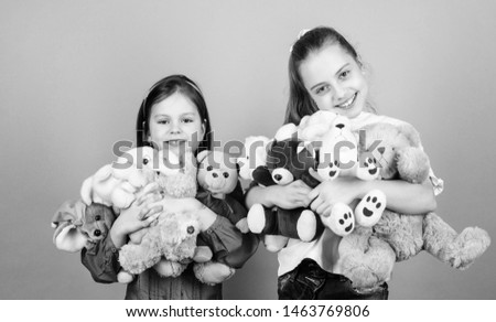 Child care. Sisters best friends play. Sweet childhood. Childhood concept. Softness and tenderness. Laundry softener. Love and friendship. Kids adorable cute girls play soft toys. Happy childhood.