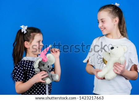 Child care. Sisters or best friends play. Sweet childhood. Childhood concept. Preparing for life. Toys store. Love and friendship. Kids adorable cute girls play with soft toys. Happy childhood.