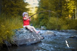 Child caught a fish on a river