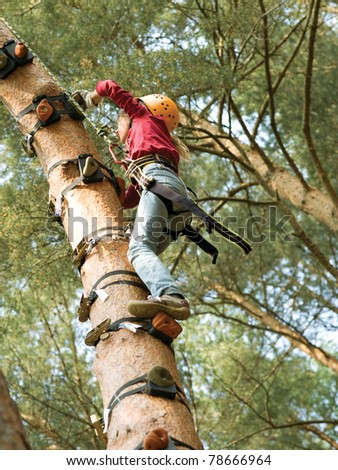 Child climbing in forest
