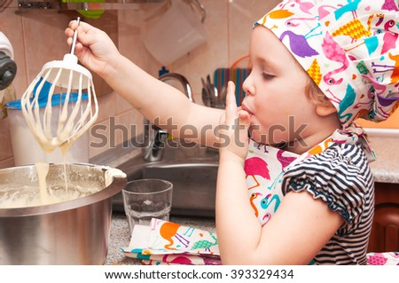 child cooking at home sweet pie, mixes ingredients #393329434