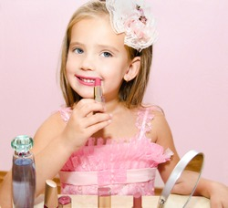 Child cosmetics  Cute little girl with lipstick isolated