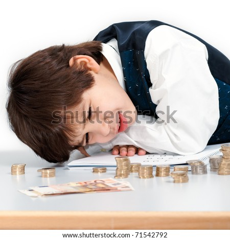 Child counting money with a worried look.