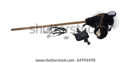 Child cowboy kit including spurs, sheriff star, saddle and a hobby horse - path included