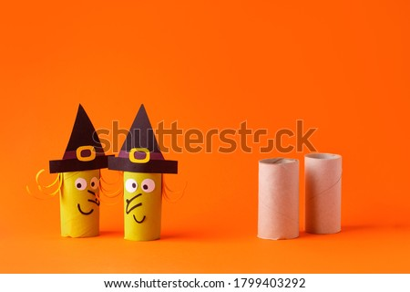 Child creates decorations for Halloween party from toilet roll. Easy eco-friendly DIY master class, craft for kids. Materials for creativity, recycle reuse concept of holiday art activities Сток-фото ©