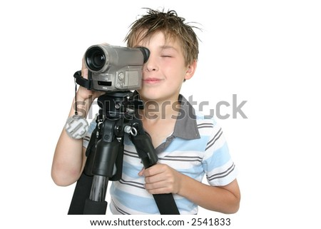 Child creating a short movie using video camera and tripod.  Whtie background