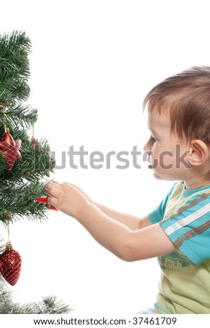 child decorating christmas tree isolated on white background