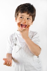 child dirty  with cake