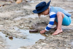 Child discovering the outdoors through play.