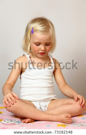 child does exercise and meditation