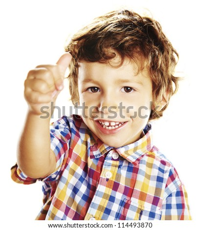child doing a positive signal with his hand