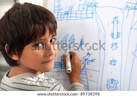 Child drawing a street scene - stock photo