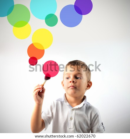 Child drawing some colored circles