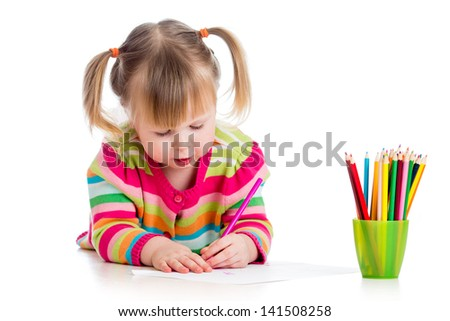 child drawing with colourful pencils