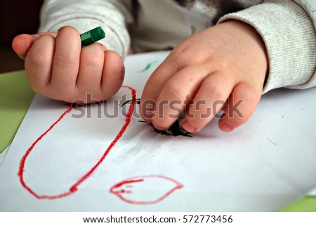 Child draws a pencil drawing of the peace. #572773456