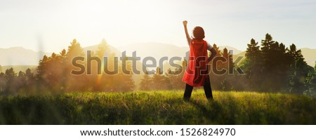 child dreaming of super hero in the mountain Сток-фото ©