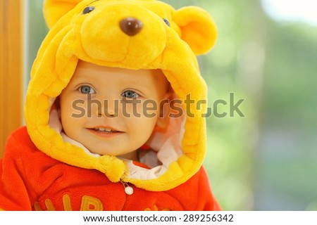 Photo of  child dressed as a bear in the window