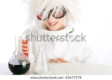 Child dressed as a mad scientist performing an experiment with beakers and colorful fluid.