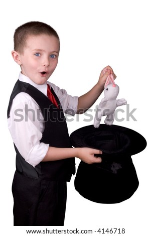 child dressed as a magician pulling a rabbit from his hat isolated over a white background