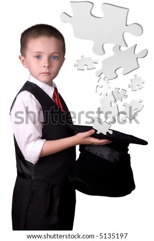 child dressed as a magician with hat full of puzzle pieces isolated over a white background