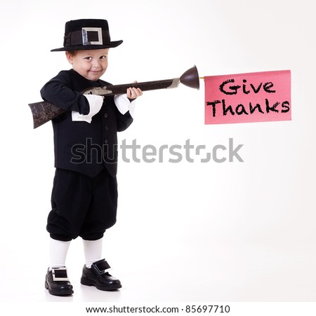child dressed as Pilgrim and giving thanks
