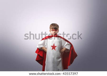 child dressed as superhero