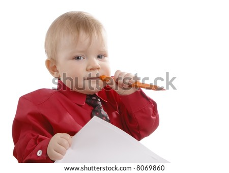 Child dressed in a red shirt and a tie  with a pencil and a paper in hands