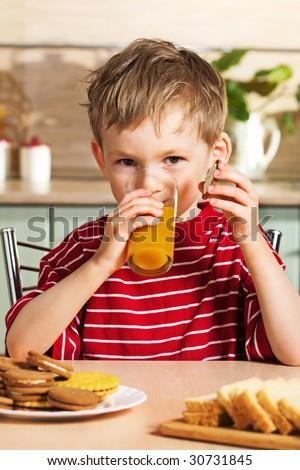 Child drinking orange juice