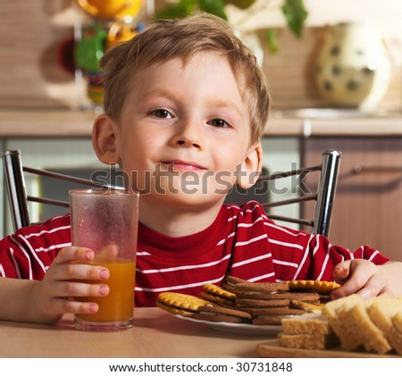Child drinking orange juice