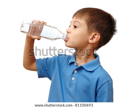 Child drinks water from bottle isolated on white background