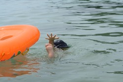 Child drowns in ocean while swimming alone, asking for help.