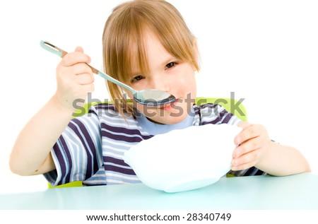 child eat soup