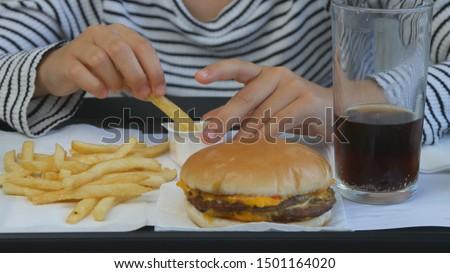 Child Eating Fast Food, Kid Eats Hamburger in Restaurant, Girl Drinking Juice