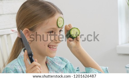 Young Happy Girl Enjoying Vegetable Salad And Smiling Images