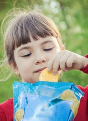 child eats chips. selective focus. food and drink.