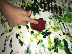 child fingers draw watercolor paints abstract flowers