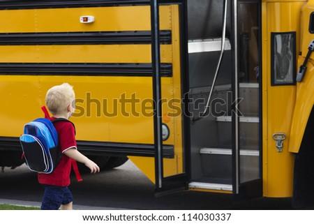 Child getting on a school bus