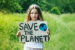 child girl activist with save the planet poster in forest park. preteen kid volunteer fight against pollution, Global Warming, recycle garbage. Ecology environmental problem.