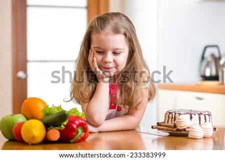 child girl choosing between...