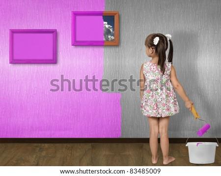 child girl doing repair, painting wall